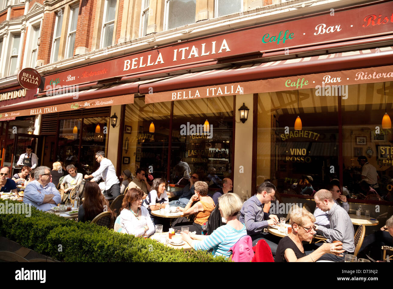 Italian restaurant exterior - Bella Italia Italian Restaurant People Eating Outside Leicester Square Central London Uk