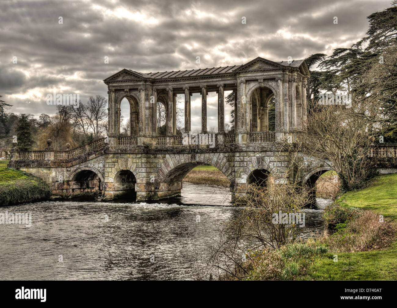 Stock Photo   Wilton House Palladian Bridge Is The Home Of The Earl Of  Pembrook And With The Stormy Sunlit Clouds Gives A Classic Look To It
