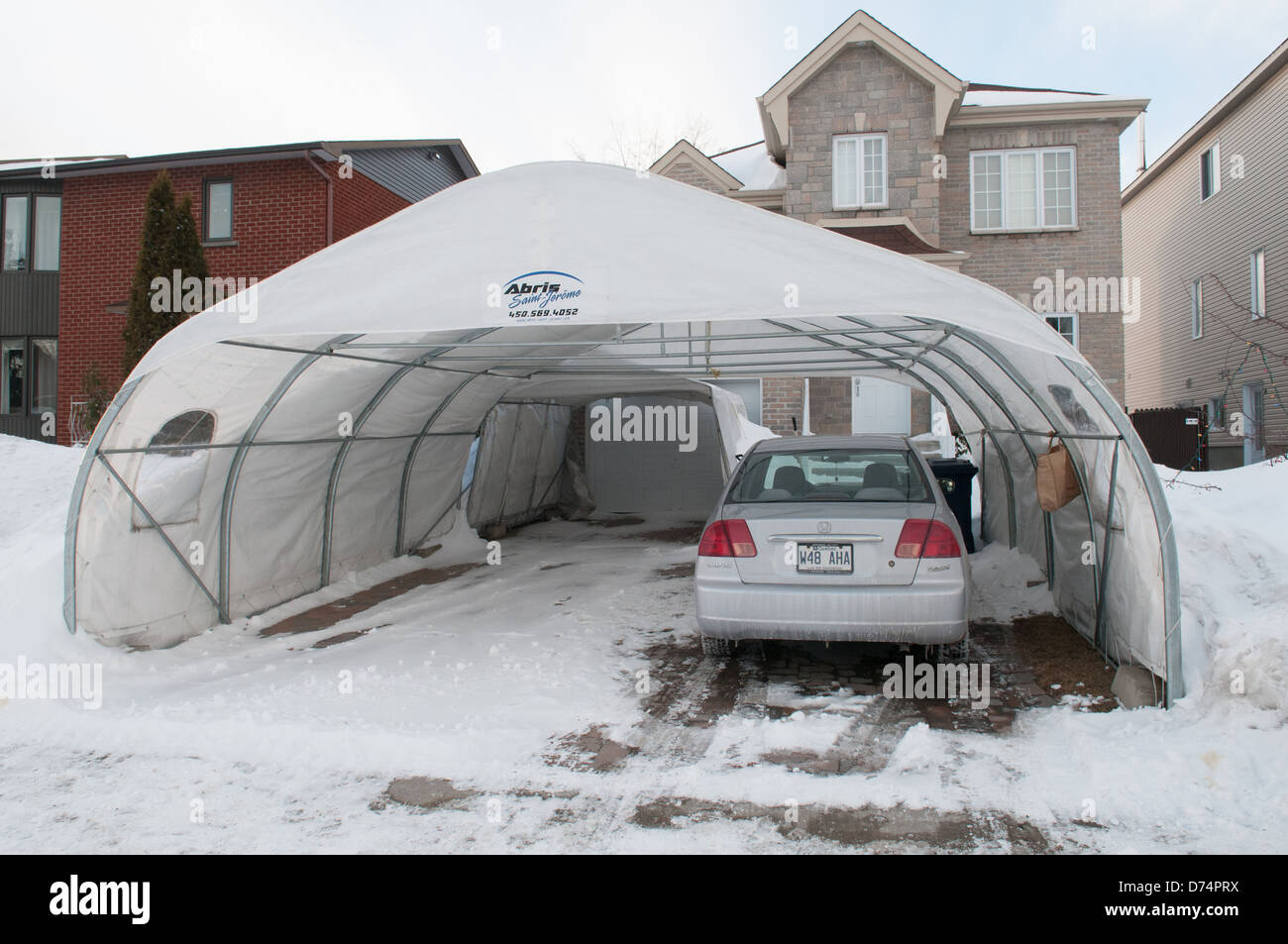 Temporary Car Shelter : Temporary tempo car shelters in a suburb of montreal