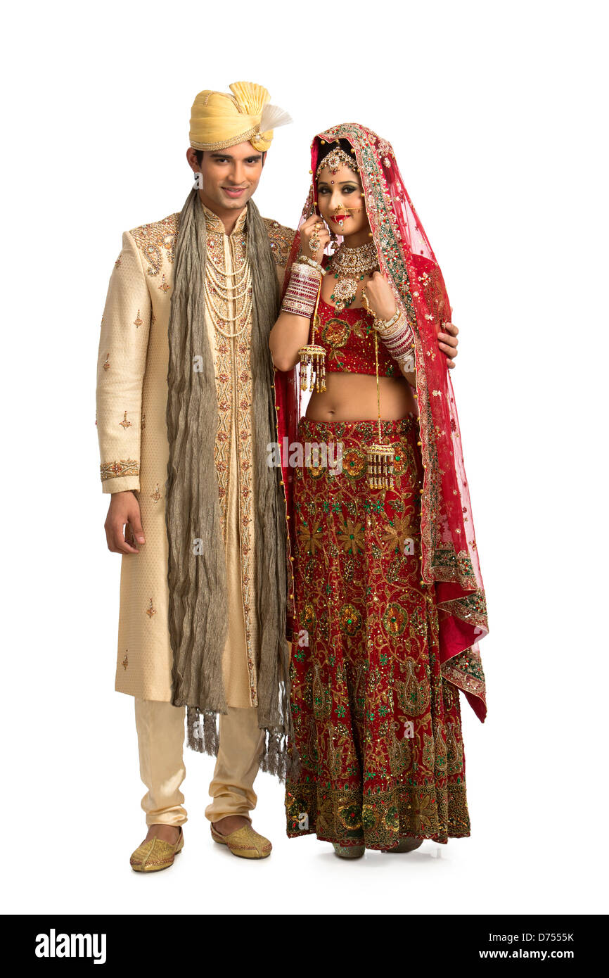 Indian newlywed couple in traditional wedding dress stock for Indian traditional wedding dress