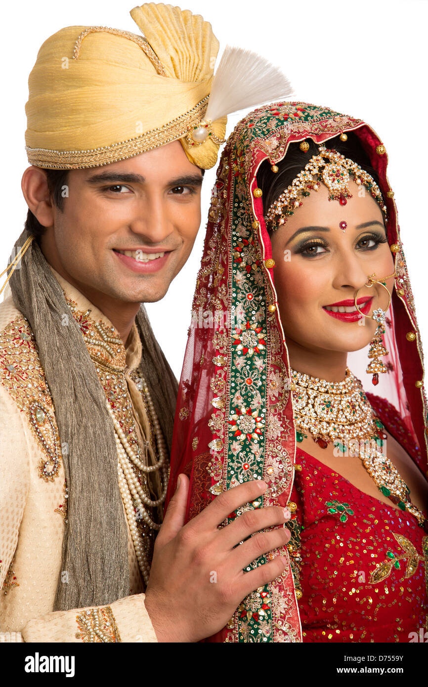Smiling Indian Newlywed Couple In Traditional Wedding Dress