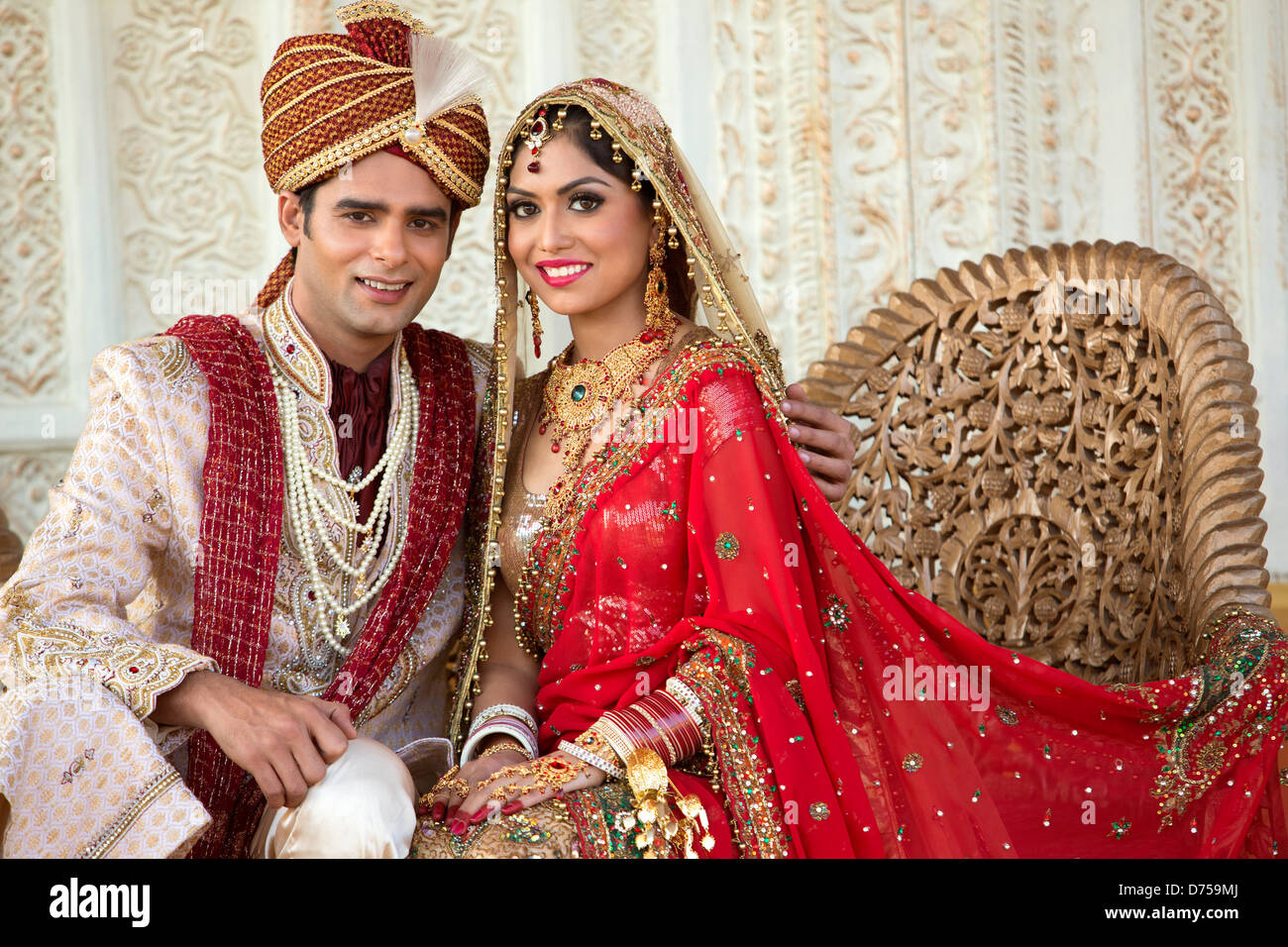 Indian Bride And Groom In Traditional Wedding Dress Sitting On A Stock Photo Royalty Free Image