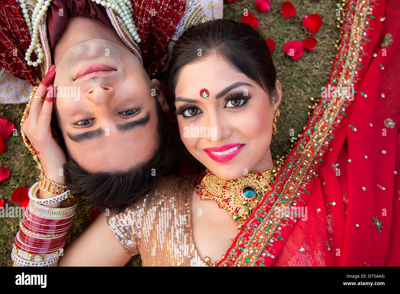 Indian Bride And Groom In Traditional Wedding Dress Posing
