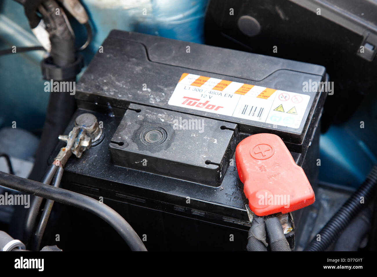 Where is the battery in a car - Stock Photo Car Battery Connected In A Car Engine Compartment