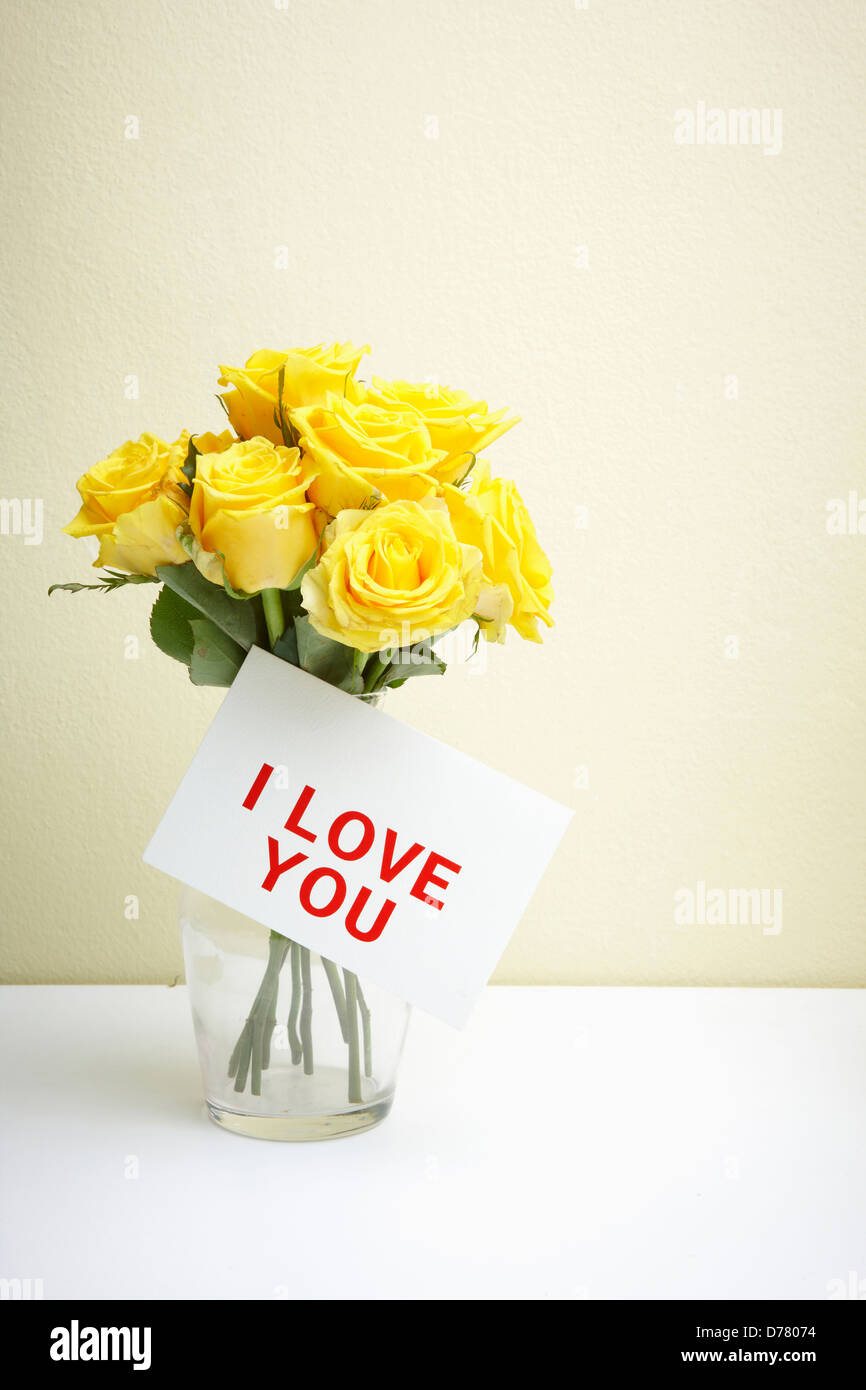 A letter saying i love you on bundle of yellow flowers in glass a letter saying i love you on bundle of yellow flowers in glass vase thecheapjerseys Images