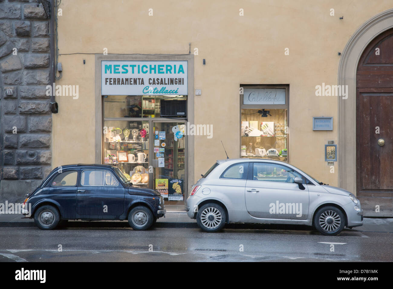 new and old fiat 500 car outside traditional shop in florence italy stock photo royalty free. Black Bedroom Furniture Sets. Home Design Ideas