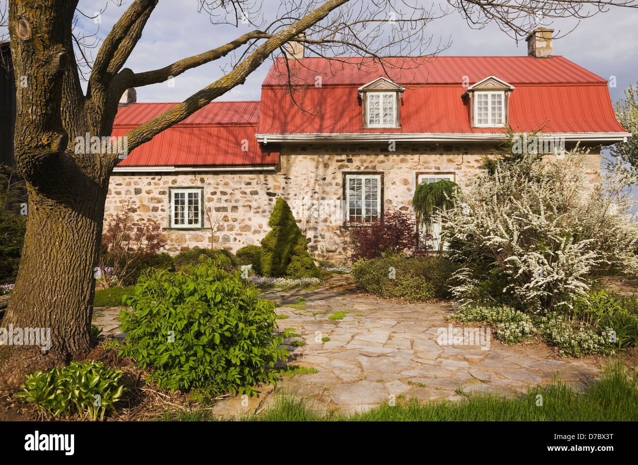 Old Canadiana (1840S) Fieldstone Cottage Style Home With Flagstone Patio In  Spring;Quebec