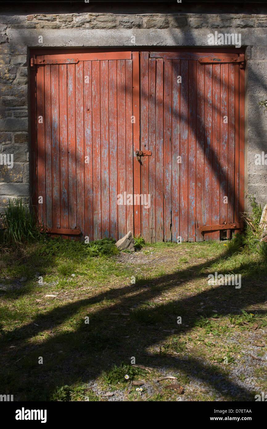 Padlocked peeling garage doors of an old stone garage in a north padlocked peeling garage doors of an old stone garage in a north somerset farm rubansaba
