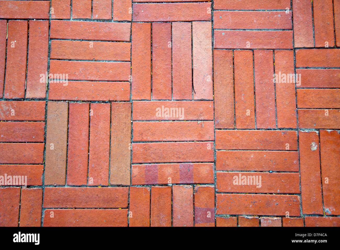Red brick shaped floor tiles lit by diffused afternoon sun good as red brick shaped floor tiles lit by diffused afternoon sun good as background dailygadgetfo Gallery