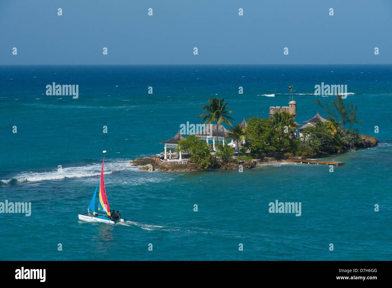 Small Catamaran Sailing Past Small Island Off Couples Tower Isle - Couples ocho rios