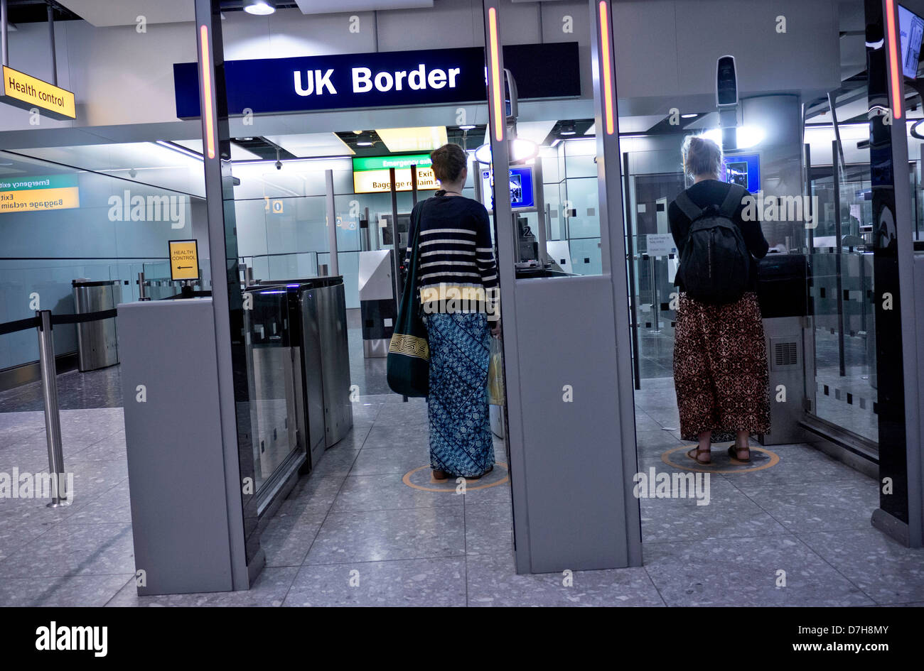 Stock Photo Uk Biometric Passport Border Control For Arriving Passengers At  London Heathrow Airport Terminal 3