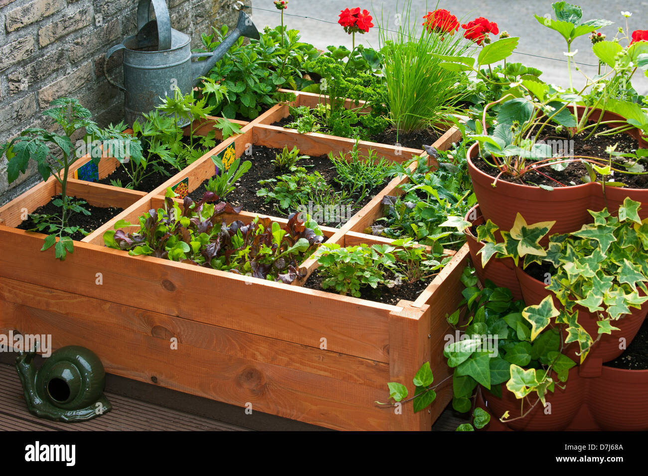 Attrayant Square Foot Gardening By Planting Flowers, Herbs And Vegetables In Wooden  Box On Balcony