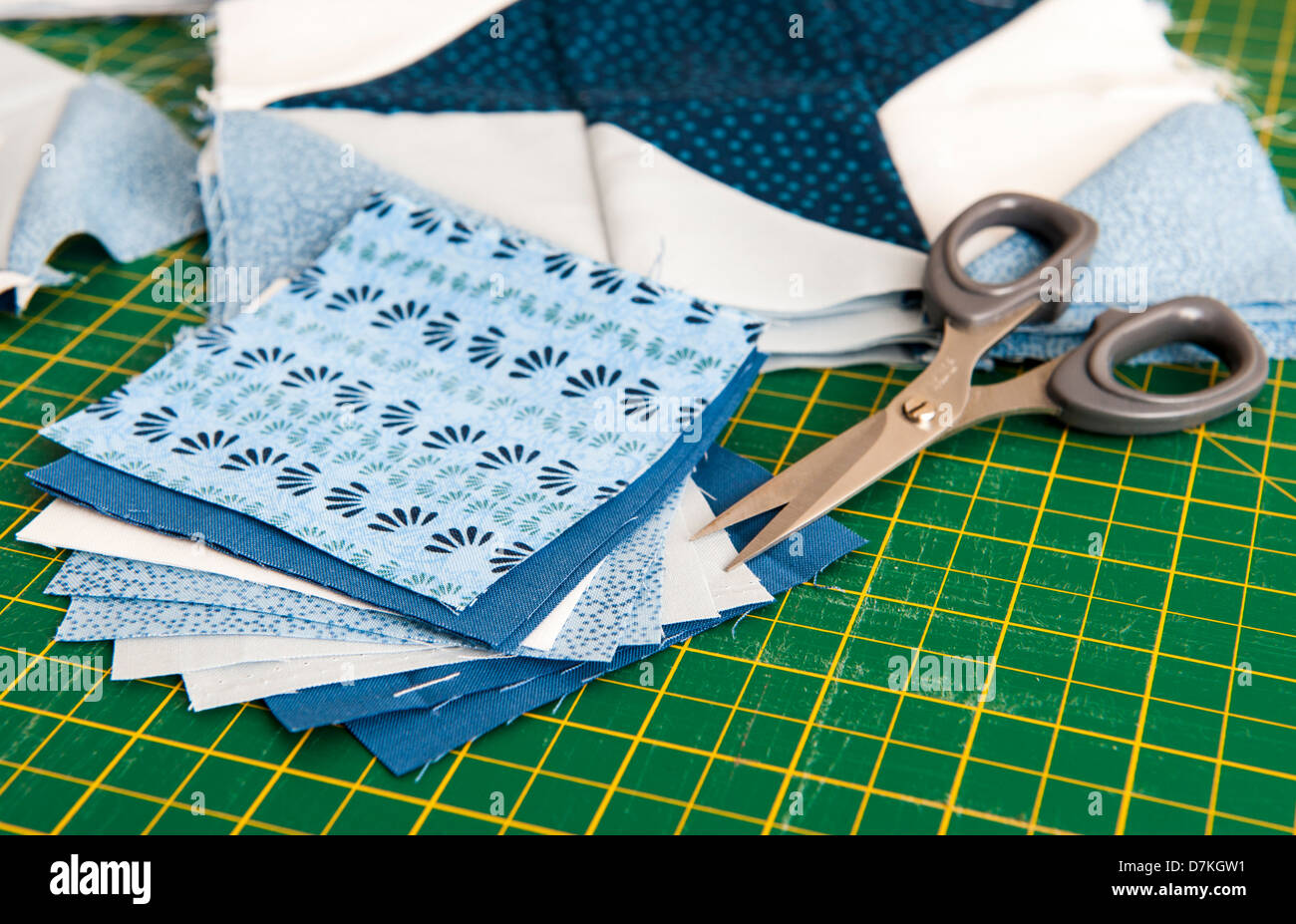 Quilting or patchwork materials and tools on a green measuring ... : quilting measuring tools - Adamdwight.com