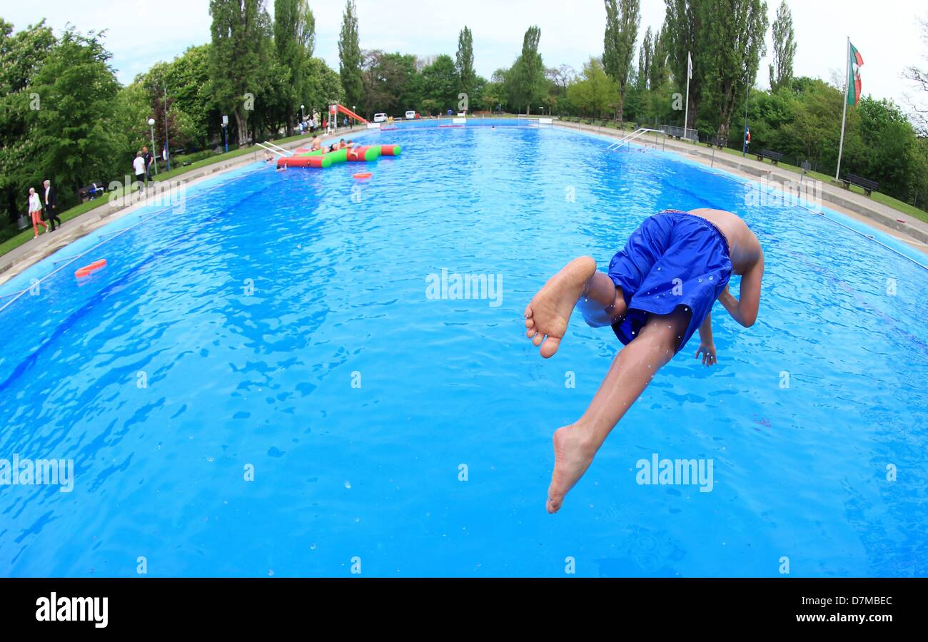 Bad Magdeburg boy jumps into an open air pool in the carl miller bad in magdeburg