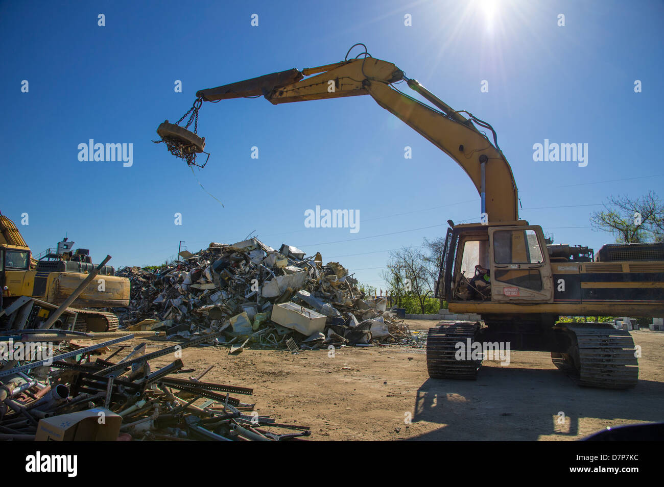 Crane With Magnet Picking Up Scrap Metal For Recycling In Junk ...