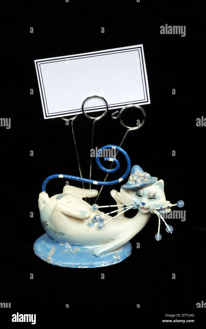 Blue and white cat ornament with business card holders against a ...
