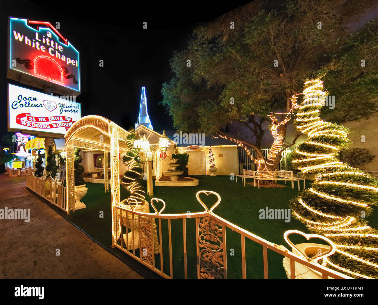 stock photo viva las vegas wedding chapel and limo statosphere tower vegas wedding chapels The Little White Wedding Chapel at night Las Vegas Nevada Stock Photo