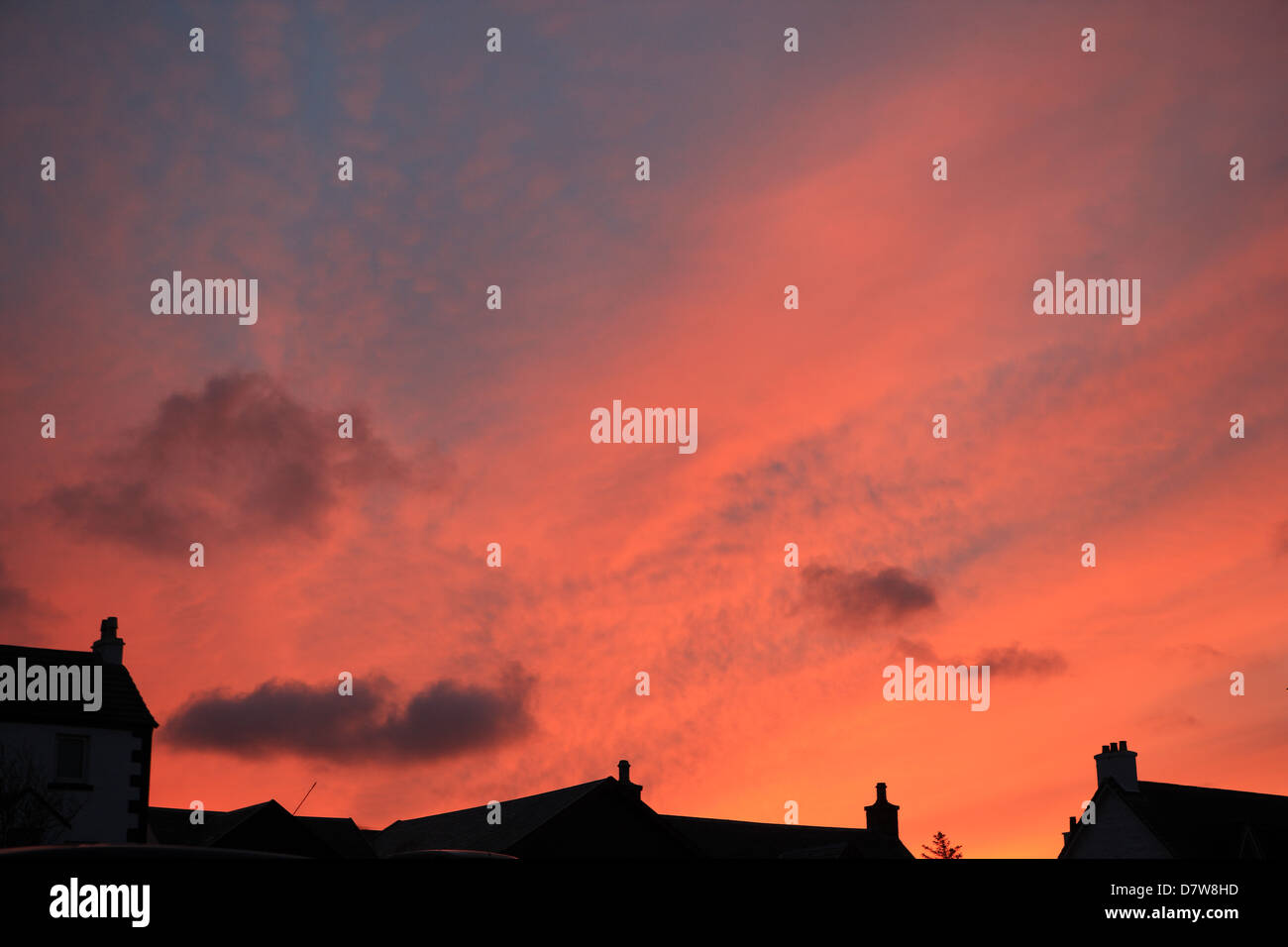 orange-sky-over-silhouetted-rooftops-in-