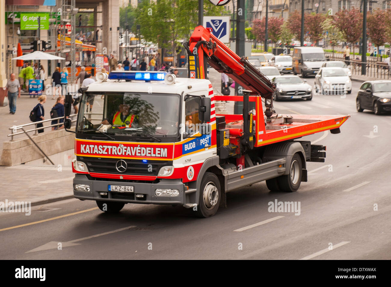 Budapest hungary flat back breakdown tow truck lorry blue emergency lights flashing stock
