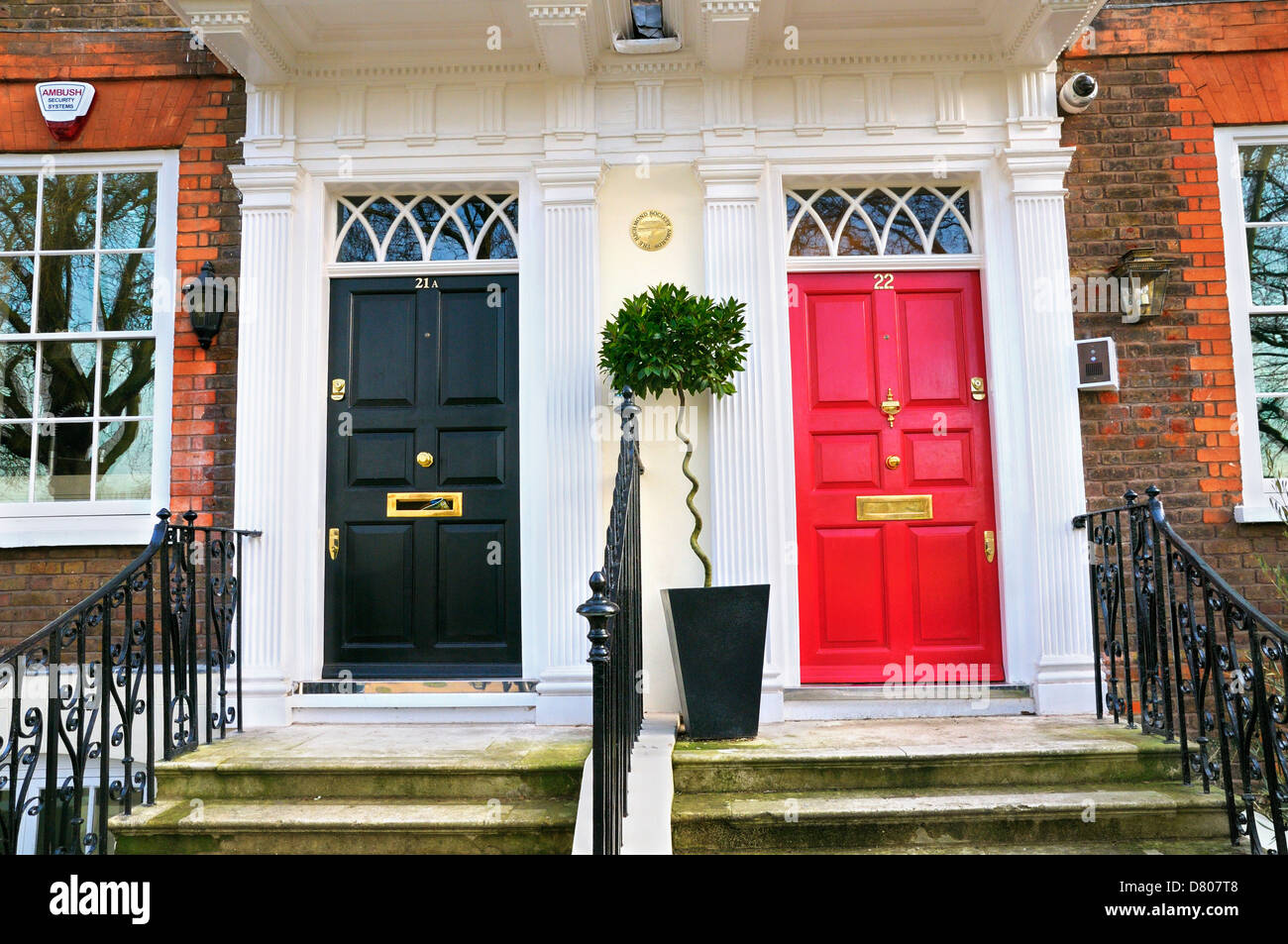 Elegant black and red front doors, Greater London, England, UK ...