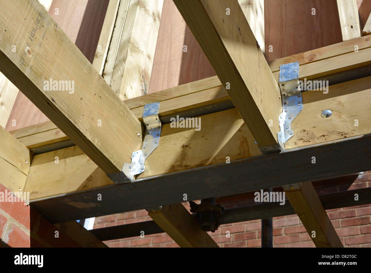 Timber floor joists pressed steel joint connectors to for Wood floor joist bridging