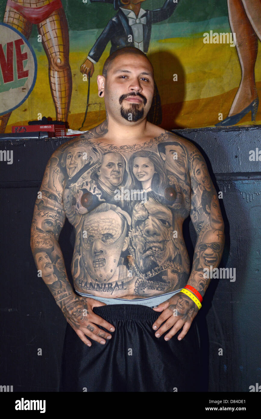 a man with multiple portrait tattoos at the new york city