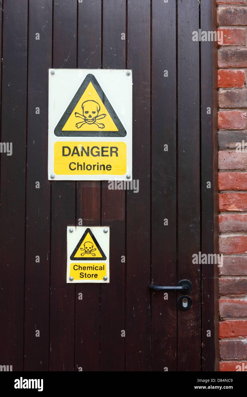 Danger chlorine sign on door of chemical storeroom at - Dangers of chlorine in swimming pools ...