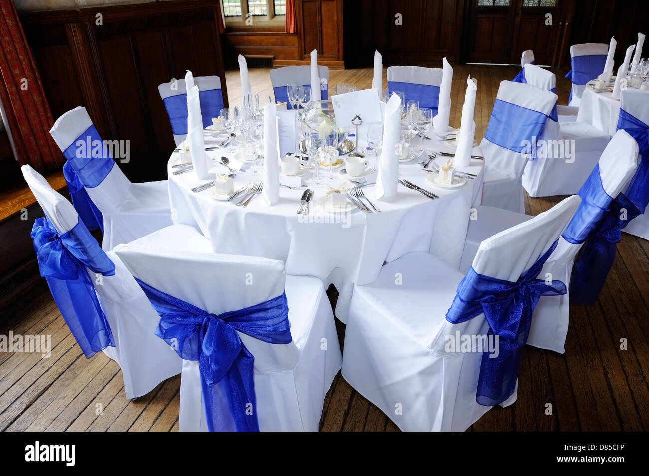White Chairs At A Wedding Indoor Stock Photo: Table And Chairs Decorated In Blue And White At Wedding