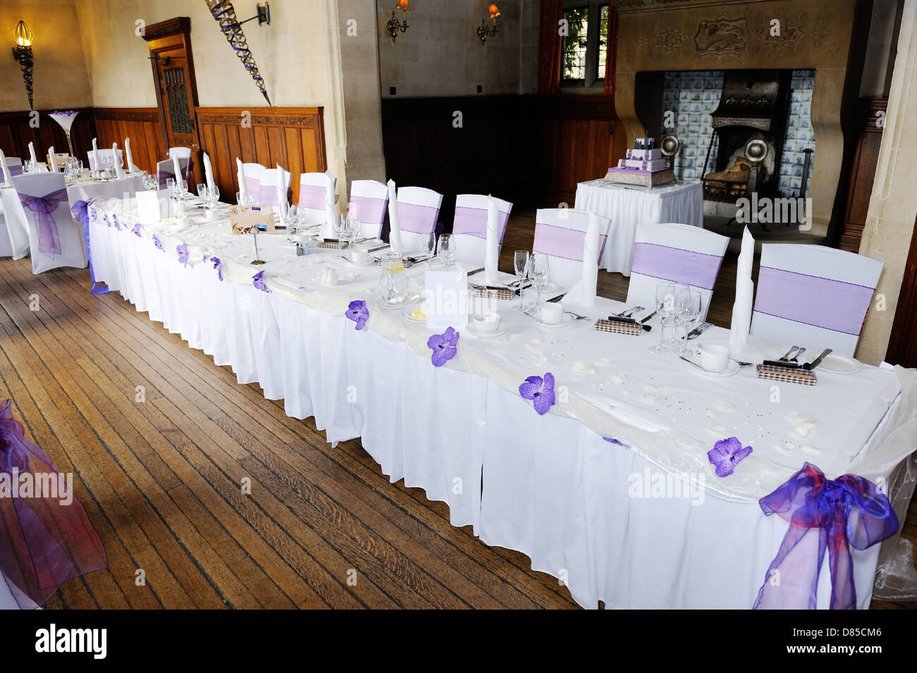 Head Table At Wedding Reception Decorated With Purple Flowers
