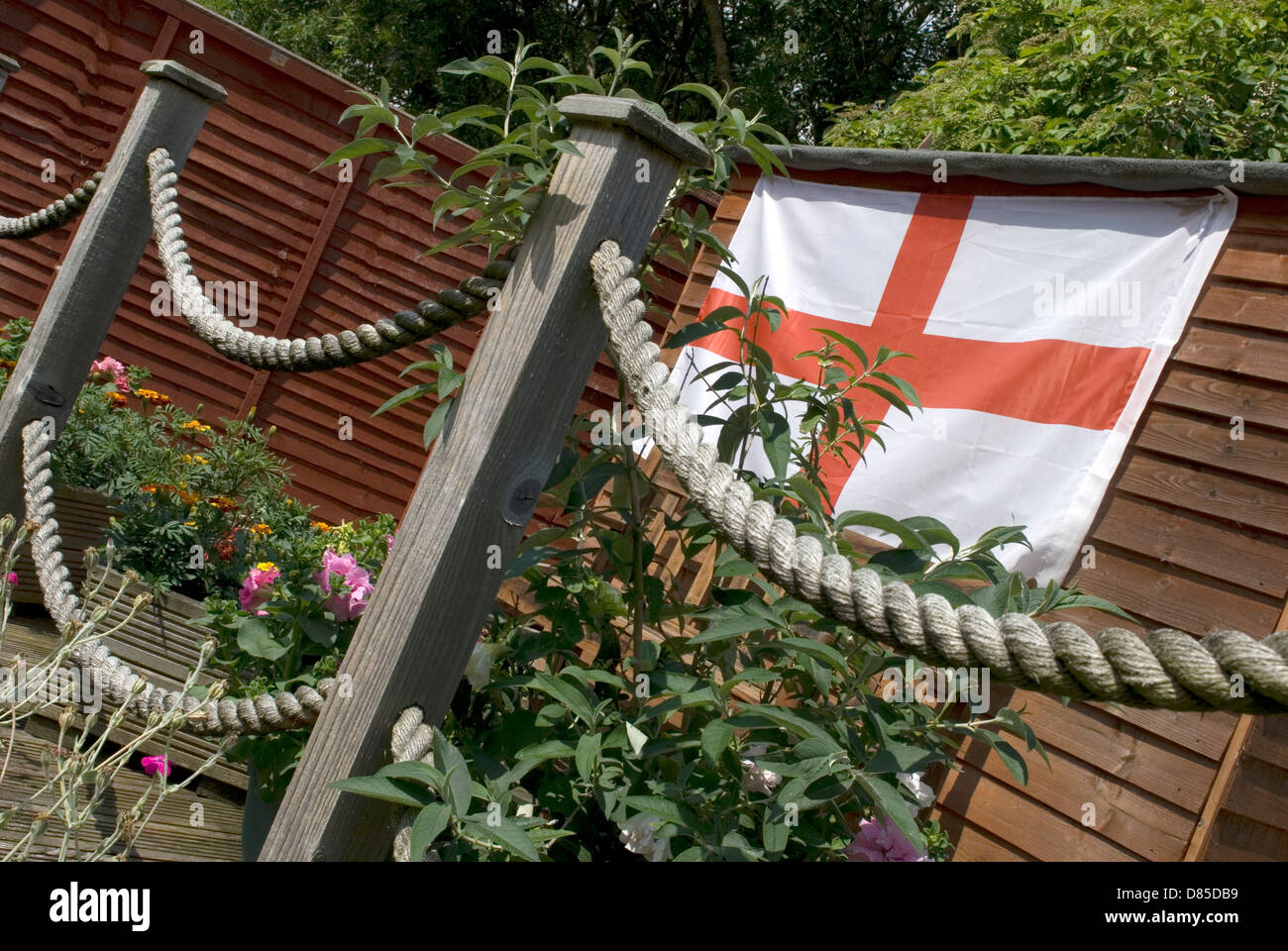 Garden Decking Posts In Spring With Rope Loops And St George Flag - Garden decking rope