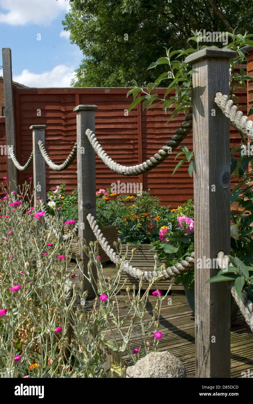 Garden Decking Posts In Spring With Rope Loops Stock Photo - Garden decking rope