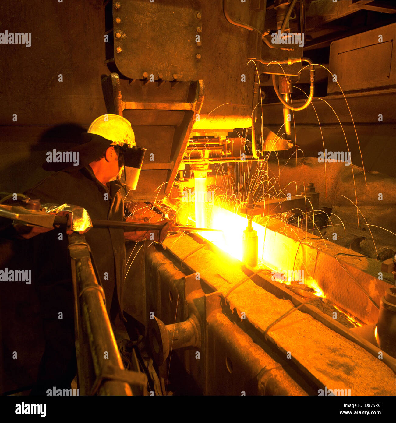 Tundish Mold Continuous Casting : Steelworker enabling flow of molten steel into tundish