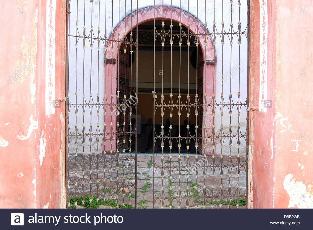 Street shot small mexican village pueblo looking into church stock photo street shot small mexican village pueblo looking into church arched door through steel gate stone patio eventelaan Image collections