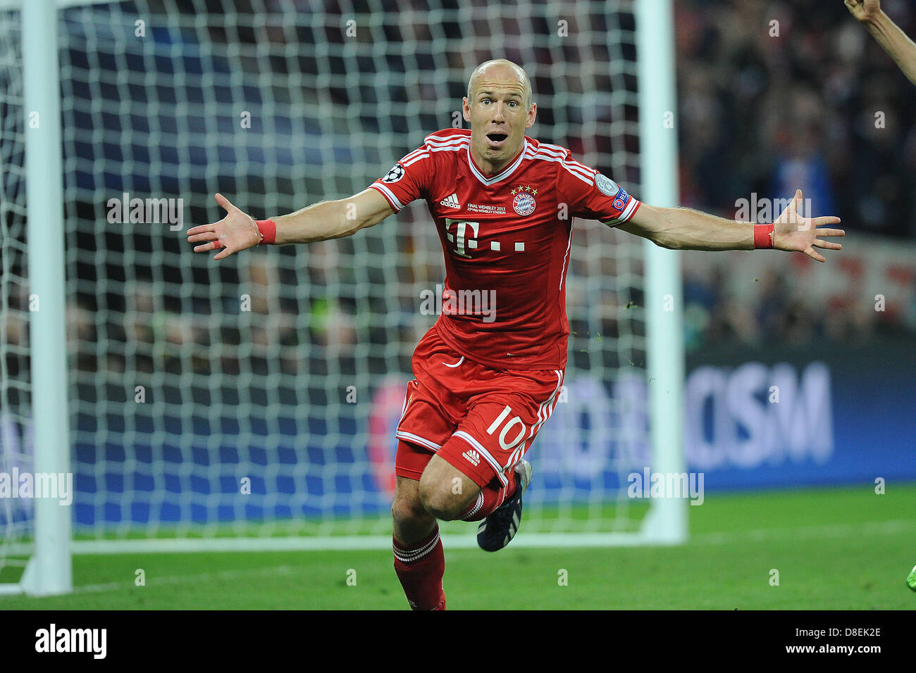 Munich s Arjen Robben celebrates his 2 1 goal during the Champions