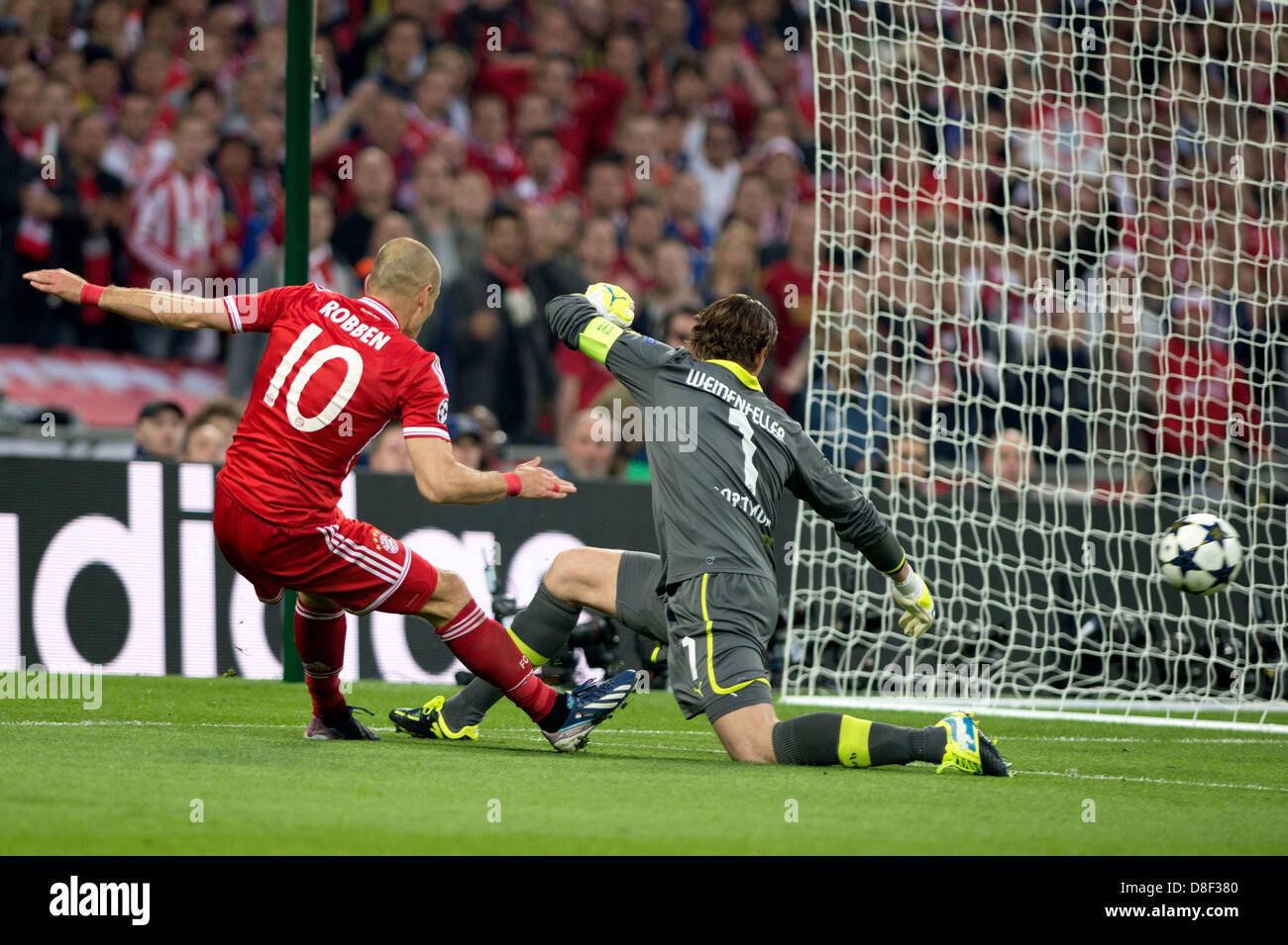 Arjen robben bayern roman weidenfeller dortmund may 25 2013 arjen robben bayern roman weidenfeller dortmund may 25 2013 football soccer arjen robben of bayern munich assists their side first goal by voltagebd Choice Image