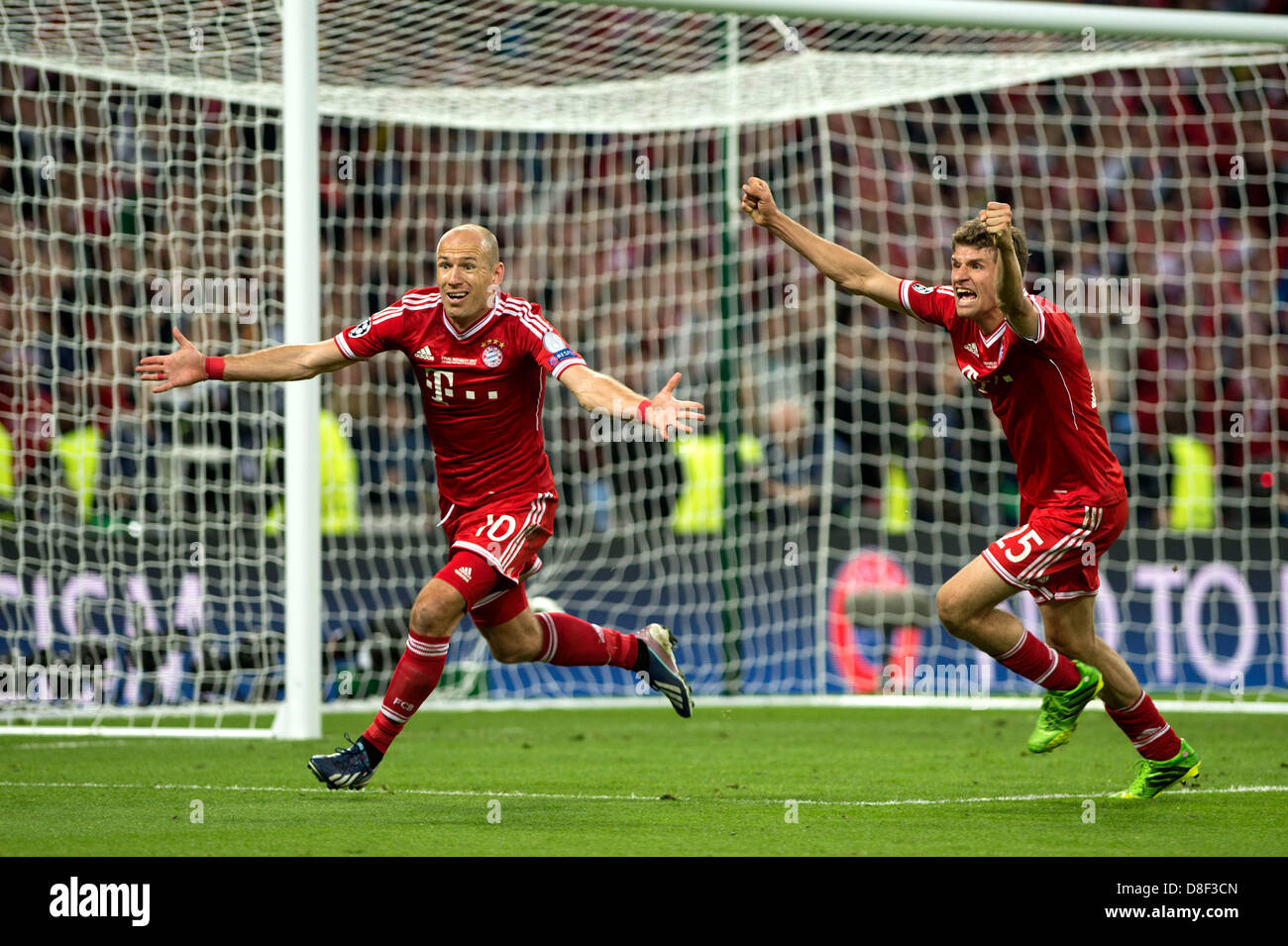 L r arjen robben thomas muller bayern may 25 2013 football l r arjen robben thomas muller bayern may 25 2013 football soccer arjen robben of bayern munich celebrates scoring his side second goal during voltagebd Choice Image