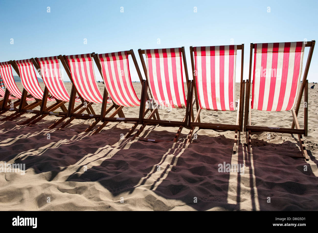Row Of Red And White Striped Deck Chairs For Hire, Barmouth, North Wales