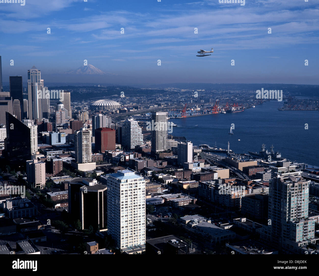 Elevated View Of City And Waterfront With A Float Plane Flying - Flying to seattle washington
