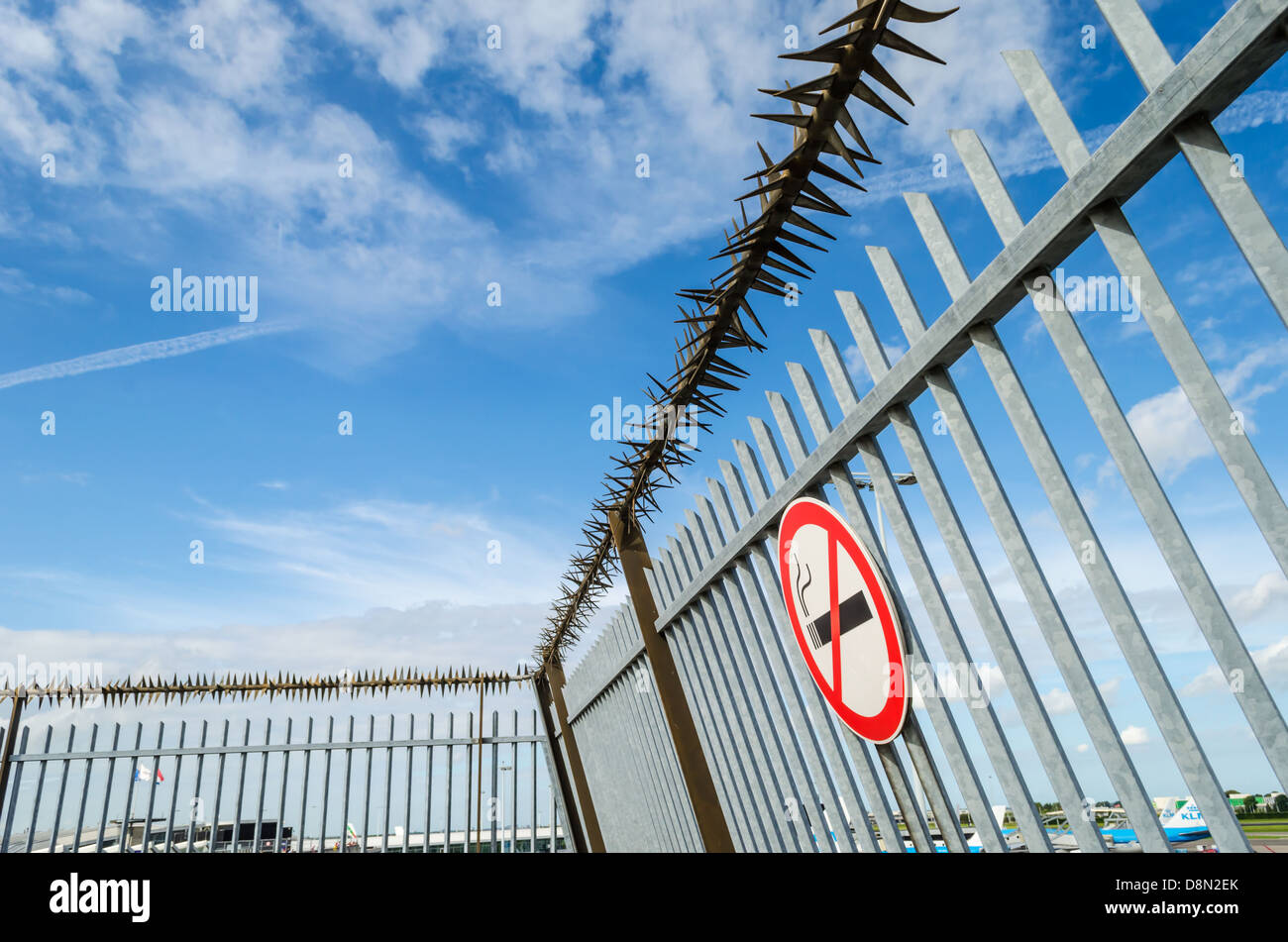 no smoking sign and a security fence at amsterdam airport schiphol amsterdam nl