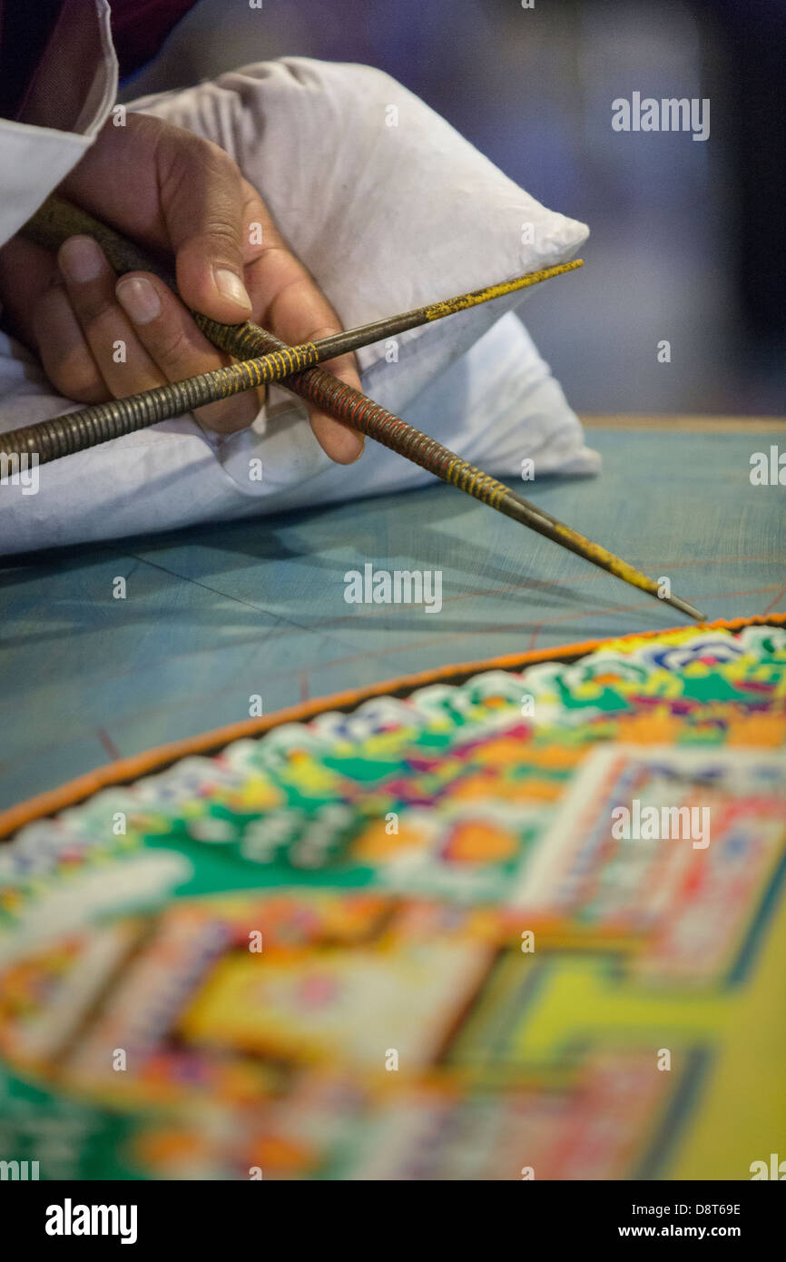 Tibetan buddhist monks craft mandala made from sand using chak a mandala is a spiritual and ritual symbol in hinduism and buddhism representing the universe biocorpaavc Images