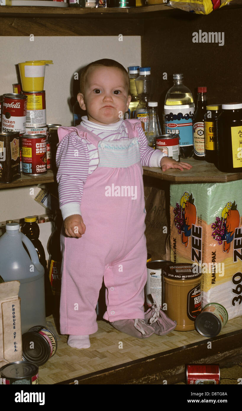 little-girl-exploring-the-pantry-closet-