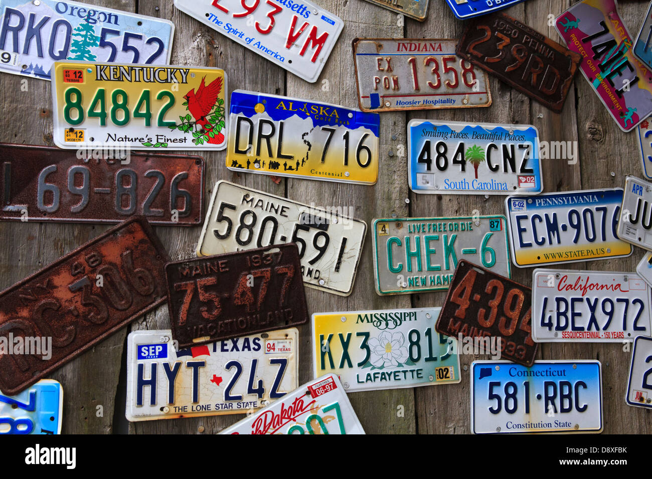 Old License plates on wall in Bar Harbor, Maine Stock Photo ...