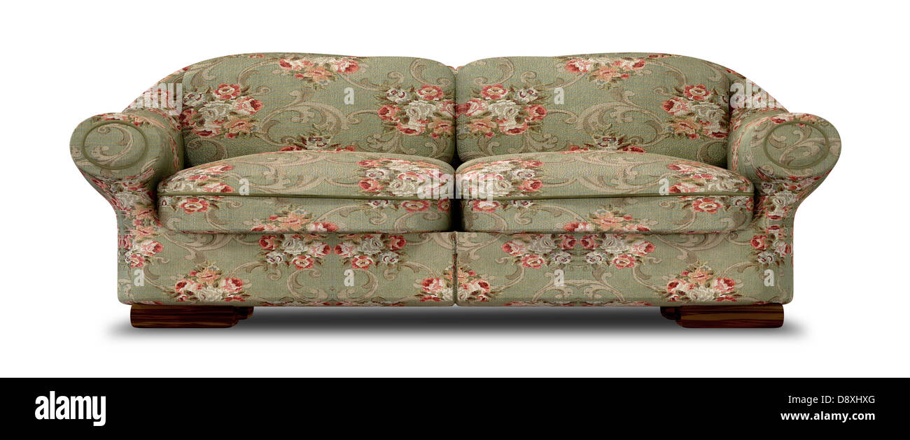 An Old Vintage Sofa With A Green And Red Floral Fabric On An Isolated  Background