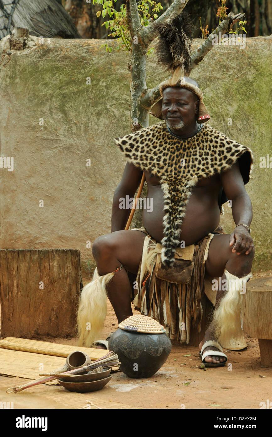 Zulu traditional dress in zulu kraal kwazulu natal -  Zulu Chief In Ceremonial Dress Sitting Next To Pot Of Traditional Sorghum Beer Shakaland Kwazulu