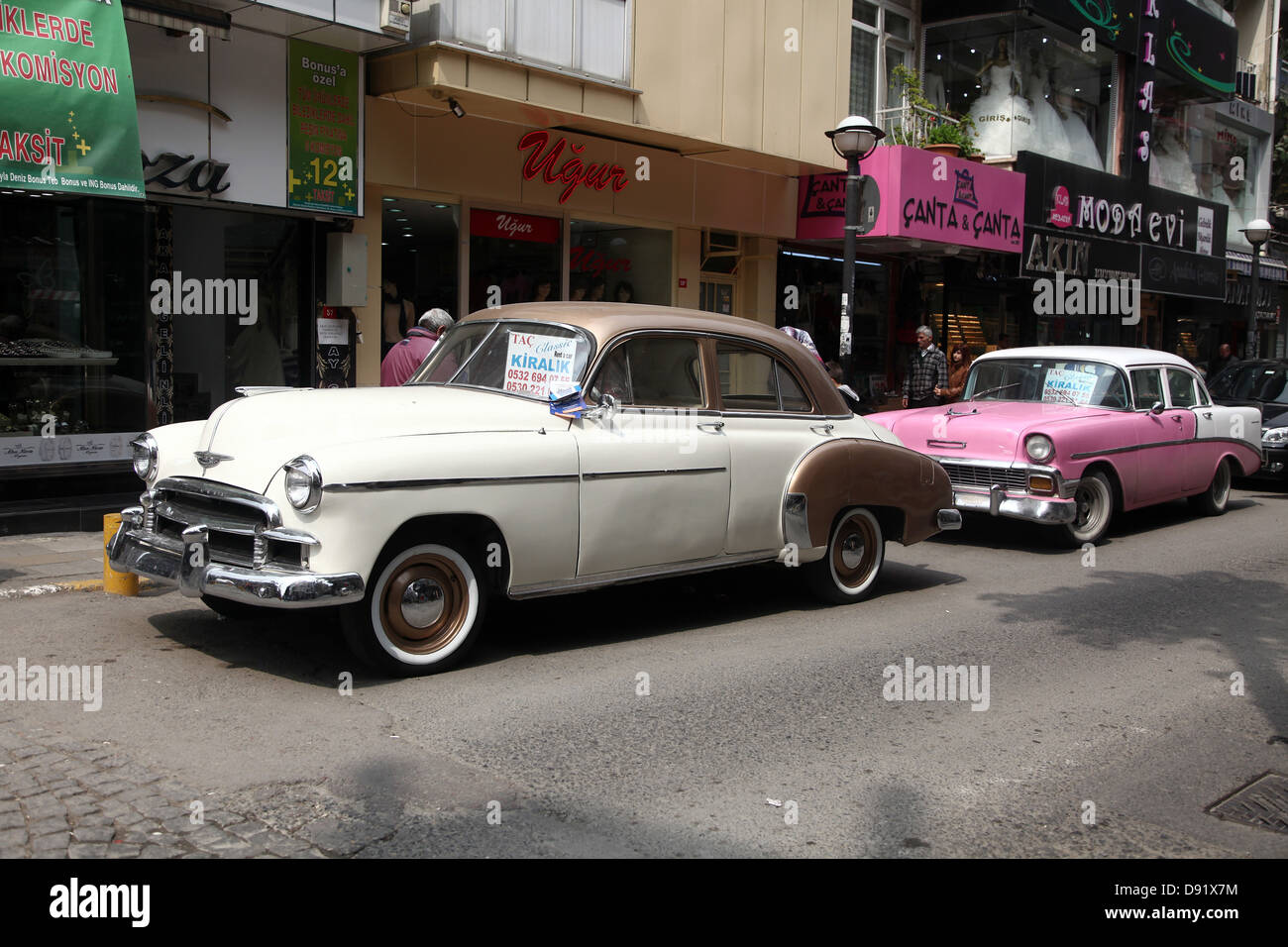 Old classic American cars on the street for hire in Pendic, a ...