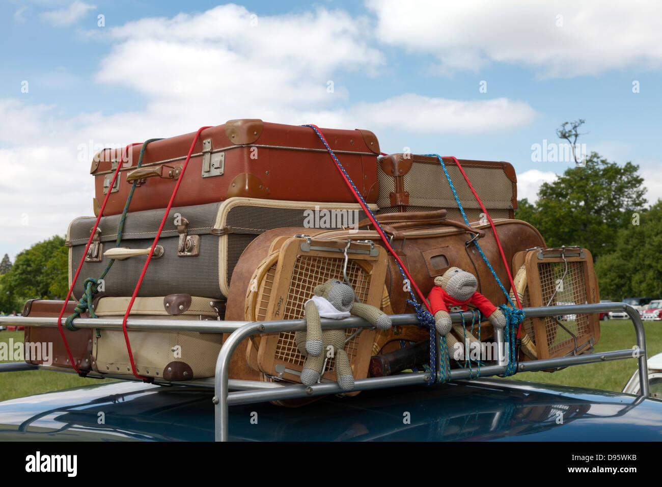 Old Style Fashioned Luggage Suitcases On Car Roof Rack