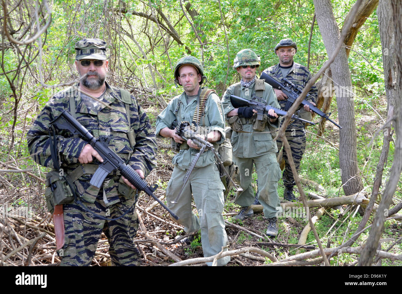 Us soldiers patrol in woods during a reenactment of the vietnam us soldiers patrol in woods during a reenactment of the vietnam war sciox Image collections