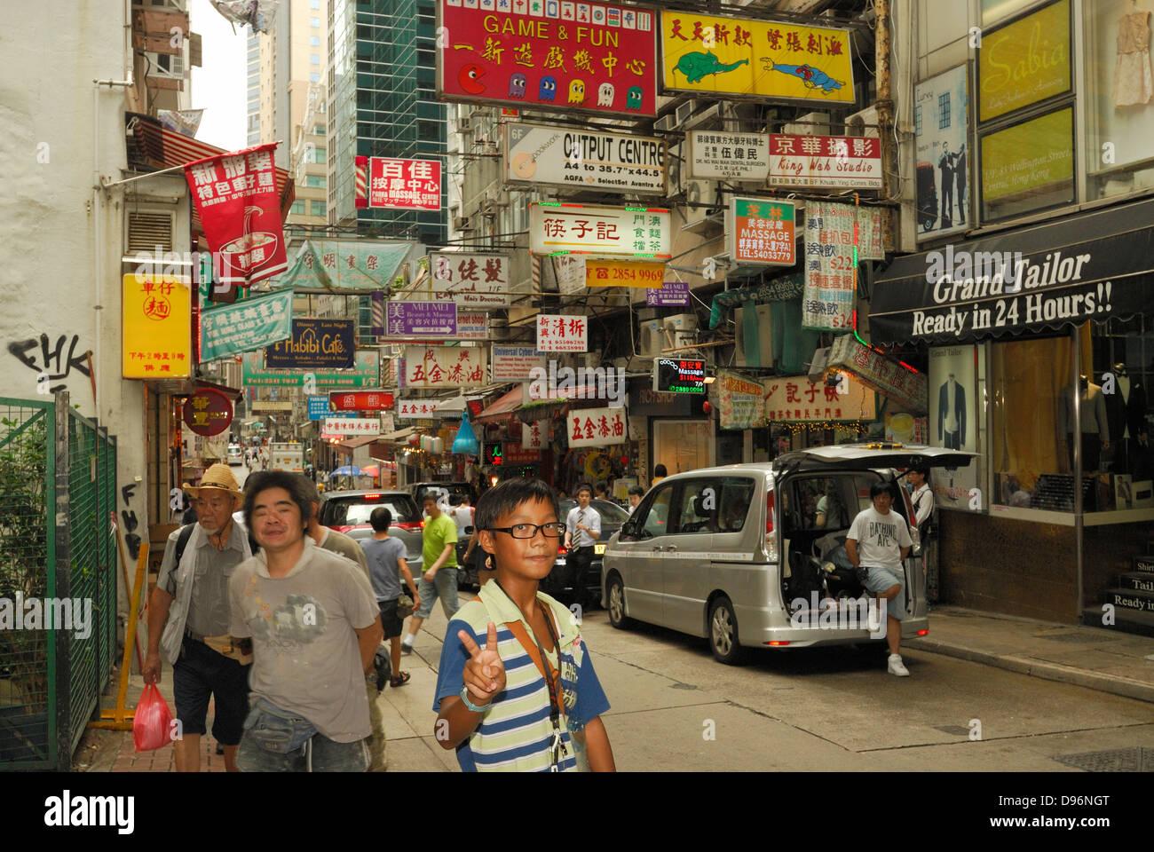 Young Asian boy giving peace sign to camera, Hong Kong China Stock ...