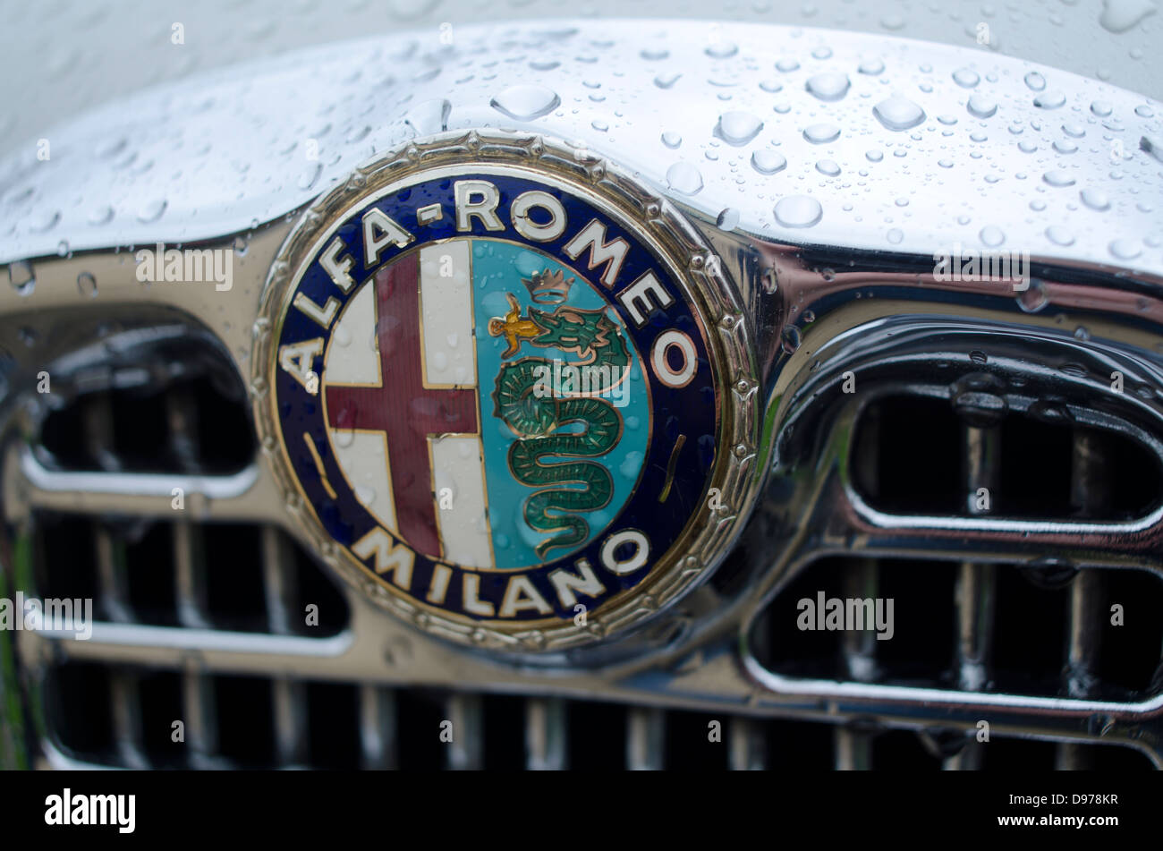 The Logo and Emblem of Alfa Romeo on the grille of an Old car of the ...