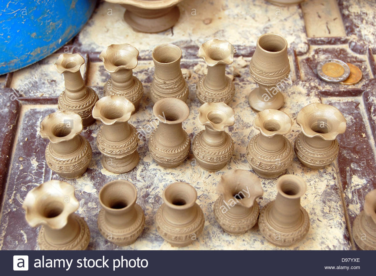 Closeup outdoor shot mexico miniature clay pottery flower vases closeup outdoor shot mexico miniature clay pottery flower vases with fine detail displayed on tile to show scale reviewsmspy